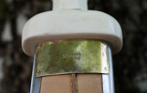 Reverse of the scabbard, with König's mark on the brass plate.